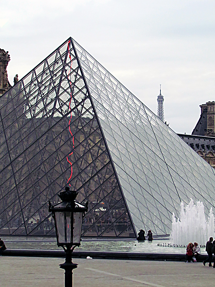 The Louvre Pyramid with Eiffel Tower in Distance - Photo by Eric F. Frazier