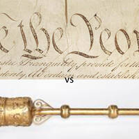 The U.S. Constitution draws its authority from the will of the people, whereas the U.K. ceremonial mace is a symbol of the crown.