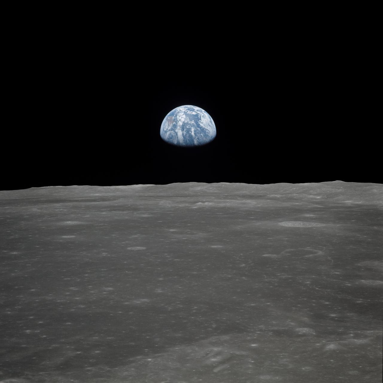 "AS11-44-6552 (16-24 July 1969) --- This view of Earth rising over the moon's horizon was taken from the Apollo spacecraft. The lunar terrain pictured is in the area of Smyth's Sea on the nearside. Coordinates of the center of the terrain are 85 degrees east longitude and 3 degrees north latitude. While astronaut Neil A. Armstrong, commander; and Edwin E. Aldrin Jr., lunar module pilot, descended in the Lunar Module (LM) ""Eagle"" to explore the Sea of Tranquility region of the moon, astronaut Michael Collins remained with the Command and Service Modules (CSM) ""Columbia"" in lunar orbit."