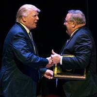 "Trump greets LePage at a rally. LePage later advocated ""authoritarian power."""