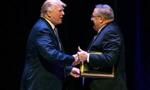 """Trump greets LePage at a rally. LePage later advocated """"authoritarian power."""""""